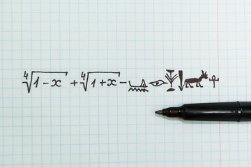 Complex mathematical examples in the notebook as Egyptian hieroglyphs.