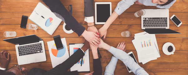 Teamwork and teambuilding concept in office, people connect hand Wall mural