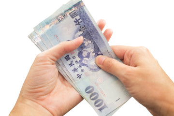 Hands with Taiwan money on isolate white background.