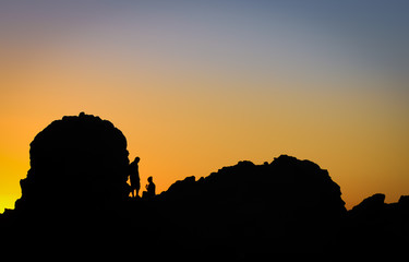 Silhouette of a Romantic Couple Enjoying Beautiful Sunset on a R