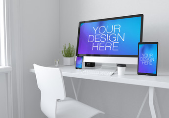3 Devices on White Table Mockup 1