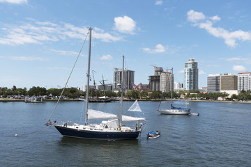 Yacht moored in the north yacht basin with a skyline view of St Petersburg Florida USA