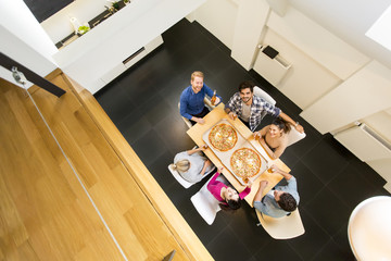 Young people have a meal in the dining room in modern home