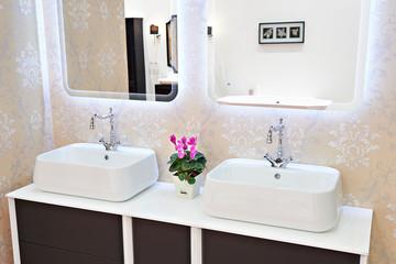 Modern washbasin, faucets in bathroom