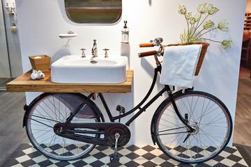 Washbasin and retro bicycle in bathroom