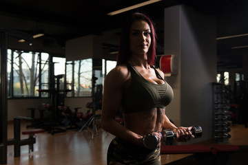 Biceps Exercise With Dumbbells In A Gym