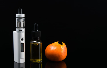 Electronic cigarette and liquid with orange taste, on a black background