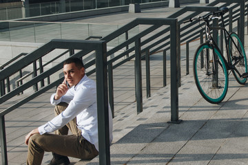 Man talking phone outside