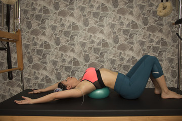 Pilates woman do streching with ball