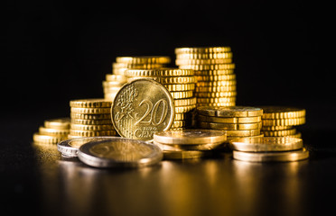 Euro coins.Coins stacked on each other in different positions. Money concept