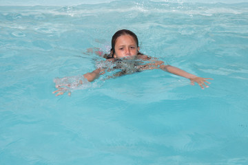 child little girl swimming in the pool water