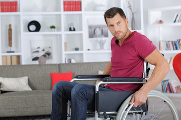 young disabled man on wheelchair
