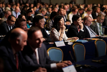 People attend an IATA meeting in Cancun