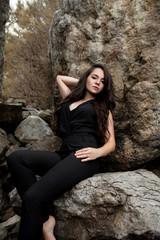 girl sitting among rocks