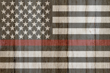 A rustic old thin red line flag on weathered wood