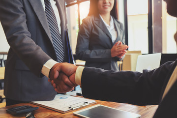 Business handshake and business people. Business executives to congratulate the joint business agreement.Vintage tone Retro filter effect,soft focus,low light.