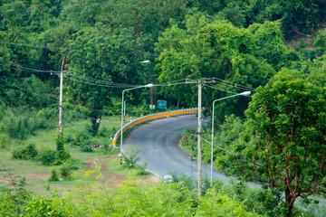 Asphalt road with Natural tree background
