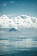 The top of the mountain among the clouds between the sea and the sky.
