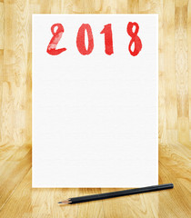 Happy new year 2018 on white paper frame with pencil in hand brush style in wood parquet room,Holiday greeting card,mock up for adding design or text