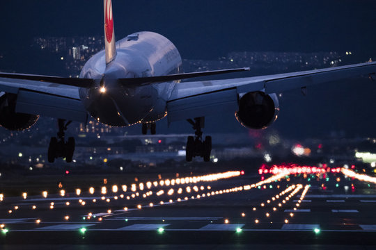 An airplane trying to land at the airport at night