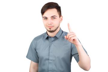 """Young man with a forefinger up, """"got idea"""" gesture, isolated. Casually handsome. Confident young handsome man while standing against white background. Happy Young Man Isolated Background."""