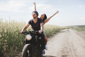 couple in field on motorcycle Wall mural