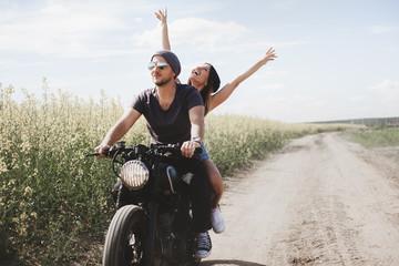 couple in field on motorcycle Papier Peint