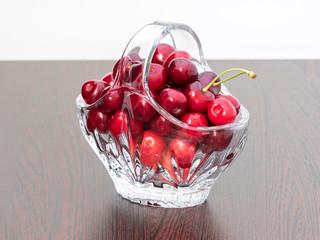 Freshly picked cherries in a crystal basket