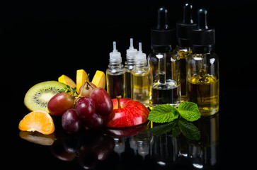 Perfume liquid in bubbles surrounded by ripe fruit and fresh mint