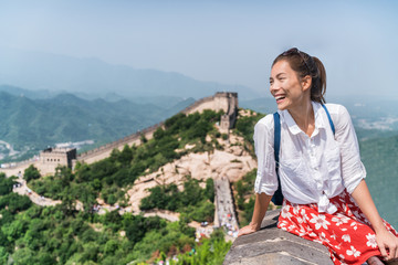 Wall Mural - Young woman tourist on Great wall of china, Asia tourism summer travel. Happy young multiracial student girl visiting famous Beijing tourist attraction, popular destination.