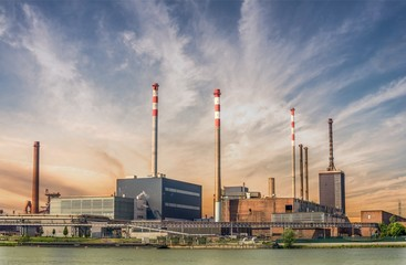 Industry concept. Factory or refinery at sunset.