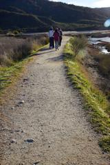 3 girls walking at national park walkway