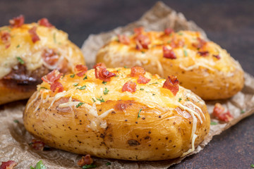 Baked stuffed potatoes with cheese and bacon