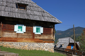 mountain village with wooden huts