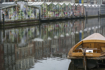 Wooden boat near the flower market in Amsterdam in the Netherlands in the cloudy day