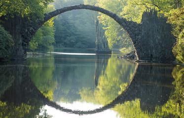 Devil's bridge in the park Kromlau, Germany,Flowering rhododendrons