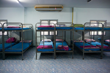 a row soldier bunk beds.