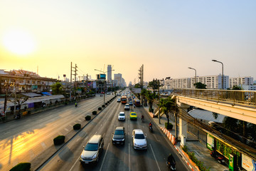View of Traffic jam at dusk in Klong Toey Road, Klong Toey district, Bangkok, Thailand.