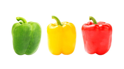 green yellow and red bell pepper on a white background.