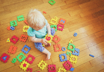 little girl playing with number puzzles