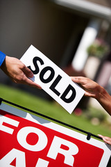 Home: Handing Homebuyer a Sold Sign