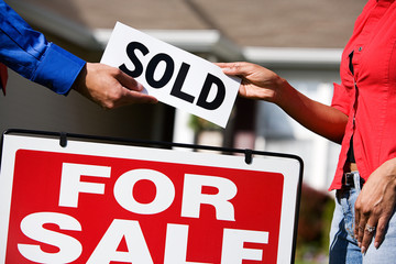 Home: Giving New Homeowner a Sold Sign
