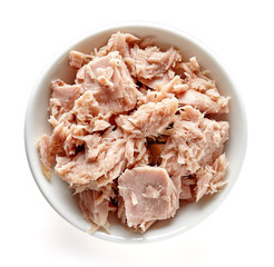 Bowl of canned tuna isolated on white, from above