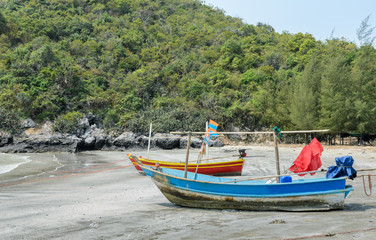 Small fishing boats on beach in Thailand