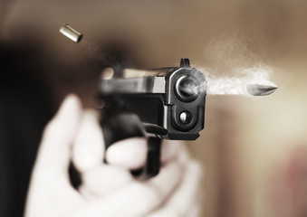 man with hand gun pistol rubber attack violence