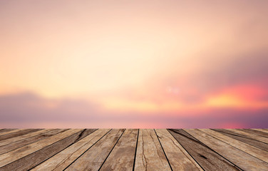 old vintage grungy brown wood panel tabletop with blurred sunset sky natural background.show your products on display.