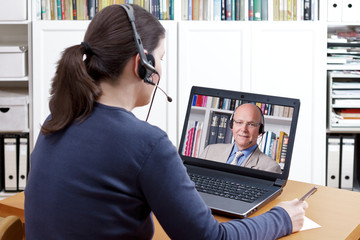 woman headset video call professor