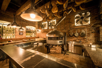 Tuinposter Pizzeria Rustic pizza oven, bar and kitchen in pizzeria interior
