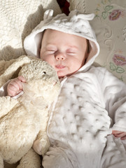 newborn baby with hat and some clothes. closeup