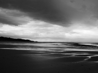 dark clouds and heavy storm on a beach in northumbria